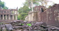 Landscape view of demolished stone architecture and aerial tree root at Preah Khan temple Angkor Wat complex, Siem Reap Cambodia. A popular tourist attraction nestled among rainforest.  74717464