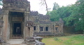 Landscape view of demolished stone architecture at Preah Khan temple Angkor Wat complex, Siem Reap Cambodia. A popular tourist attraction nestled among rainforest.  74717487