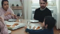 Young family eating vegan pizza at home 74756311