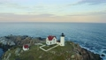 Aerial view of Nubble lighthouse in York, ME at sunset 74804873
