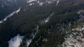 Scenic Aerial B-roll with Wild Mountains Woods and Peak Range in Winter Day 74810790