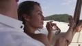Young beautiful girl enjoys sailing on a yacht 74852118