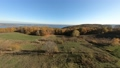 FPV aerial drone view. Flying above autumn forest hills near Dnipro river 74958140