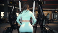 beautiful caucasian woman in the gym. Back bent-over rows exercises in gym. Pumping up muscles workout fitness and bodybuilding concept. 74969749