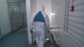 workers in protective suits go to production 75012400