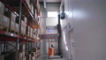 the loader lifts the goods onto the warehouse shelves 75012402