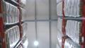 aisle between the warehouse shelves 75012406