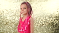 Stylish girl with pink dreadlocks and posing on a yellow sequin background. Beauty, fashion 75040756