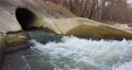 Waste water flowing into the river 4k Footage 75100721