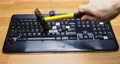Shattering keyboard with hammer slow motion footage 75100743