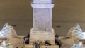 people are gathering under the central column on piazza del popolo during night timelapse 75116000
