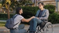 Supporting a man in a wheelchair 75174716