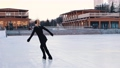Young woman training her figure skating on public ice rink 75209788