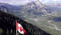 National Flag of Canada with Town of Banff in background. Cascade Mountain and surrounding Canadian Rocky Mountains in summer time. Banff National Park, Alberta, Canada. 75247835