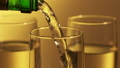 Pouring champagne wine into glasses. Celebrating concept 75308416