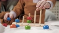 Baby hands playing educational game. Slow motion and close-up 75360064