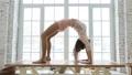 Young sporty woman doing gymnastic bridge exercise  75367234