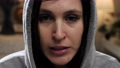 Workout at home. Beautiful young woman does cardio exercise with all her strength, close-up of face of very sweaty and tired woman. Close-up and slow motion 75424177
