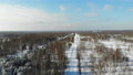 aerial shot flying over winter snow woods road video 75436617
