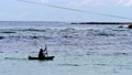 Silhouette of fisherman rowing in canoe and coming back from fishing 75438330