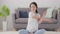 Senior woman stretching in the living room at home 75489294