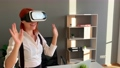 Business woman wearing VR goggles and interacts with cyberspace 75504458