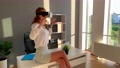 Business woman wearing VR goggles and interacts with cyberspace 75504460