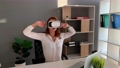 Business woman wearing VR goggles and interacts with cyberspace 75504467