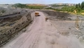 Large quarry dump truck. Loading rock in dumper. Loading coal into truck. Mining car machinery to transport coal. Open pit mine quarrying extractive industry stripping work. Big Yellow Mining Trucks 75529950