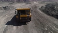 Large quarry dump truck. Loading rock in dumper. Loading coal into truck. Mining car machinery to transport coal. Open pit mine quarrying extractive industry stripping work. Big Yellow Mining Trucks 75529953