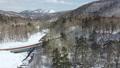 冬の北海道 雪景色と渓流(支笏湖周辺 空撮) 75586829