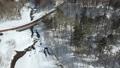 冬の北海道 雪景色と渓流(支笏湖周辺 空撮) 75586830