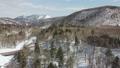 冬の北海道 雪景色と渓流(支笏湖周辺 空撮) 75586833