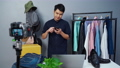 man selling clothes and accessories online by using smartphone and camera live streaming 75590292