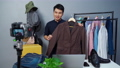 man selling clothes and accessories online by camera live streaming, business online e-commerce  75590293
