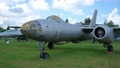 Old jet fighter aircraft in open-air military museum. 75608512