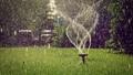 Lawn sprinkler turning head working tilt up shot 75646155