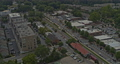 Woodstock Georgia Aerial v3 dolly out shot of traffic, low rise neighborhood and forest - Shot with Inspire 2, X7 camera - August 2020 75649128