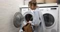 Woman washing clothes at home 75668917