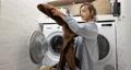 Woman washing clothes at home 75668918