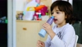 child does self nasal washing or nasal shower alone with special wireless device 75693462