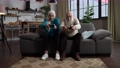 Excited aged couple playing computer game at home 75707589