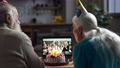Joyful elderly couple during online Birthday party 75707595