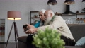 Modern old people during domestic gaming activity 75707599