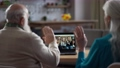 Elderly couple during video call at laptop 75707605