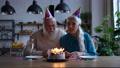 Joyful elderly couple during Birthday celebration 75709022