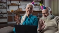 Attractive old couple during online Birthday party 75709023