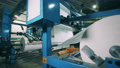 Large paper converting machine at a paper manufacturing plant 75767433