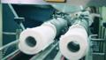Paper roll cutting machine at a paper mill 75767437
