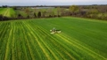 Aerial view Agriculture. Food industry. Agricultural work. Farming tractor. Green field, agricultural works. 75780443